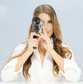 Nice, glamour lady with old film camera