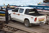 Pickup Truck Driving Onto a Ferry in Tiquina, Bolivia