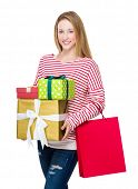 Woman holding shopping bag and present box