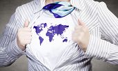 Young woman tearing shirt on chest with world map
