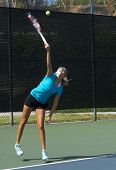Junior Tennis Player Serving