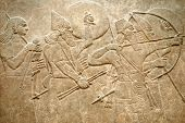 stock photo of sumerian  - Assyrian 8th century BC relief showing Assyrian soldiers in battle - JPG