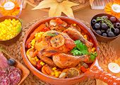 Thanksgiving day dinner, traditional festive food, tasty oven baked turkey with vegetables and lemon, beautiful decorated holiday table