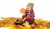 girl on autumn leaves studio shoot on white