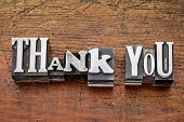 thank you - words in vintage metal type printing blocks over grunge wood, mixed fonts in style and size