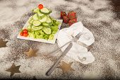 picture of christmas meal  - A Christmas tree salad made with cucumber and cherry tomatoes a healthy kid meal - JPG