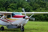 propeller airplane on soft  strip