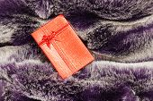 Red Gift Box On Fur Texture.