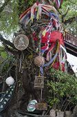Phuket,TH-Sept,15 2014:Bedizened tree at the entrance to bar. Kata Bay in Sept,15 2014 in Phuket,TH