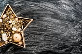 Beautiful Christmas Star with toys on a black textured background