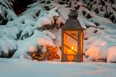 a street lamp glowing in the snow at christmas. romantic light