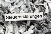 tagged with shredded paper tax returns, symbolic photo for tax burden and obligation to preserve