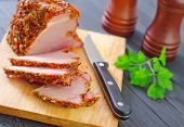 picture of smoked ham  - smoked ham and parsley on board and on a table - JPG