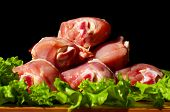 raw chicken legs and green salad