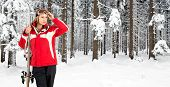 foto of blanket snow  - Skiing woman posing in the deep snow woth a forest - JPG