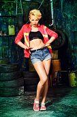 Modern girl dancer dancing in the garage. Urban lifestyle. Hip-hop generation.