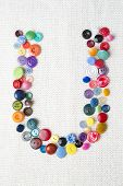 Letter U Of The Alphabet Of Buttons Of Various Shapes And Colors