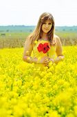 foto of rap-girl  - girl with bouquet of poppies in the raps field - JPG