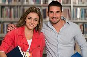 Portrait Of A Student Couple In A Library