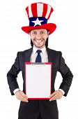 Businessman wearing USA hat with paper on white