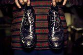 Old  Men's Black Shoes In Men's Hands