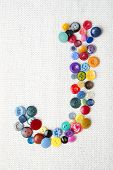 Letter J Of The Alphabet Of Buttons Of Various Shapes And Colors