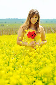 pic of rap-girl  - girl with bouquet of poppies in the raps field - JPG