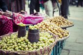 The Street Vendor Sels His Fruits And Vegetables In Thamel In Kathmandu, Nepal. poster