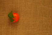 stock photo of clementine-orange  - Juicy Orange Clementine with Leaves on Hessian - JPG