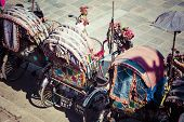 stock photo of rickshaw  - Rickshaw is a very popular type of public transport in cities in Nepal - JPG