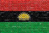 image of civil war flags  - flag of Biafra painted on brick wall - JPG