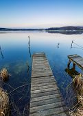 foto of pier a lake  - Small pier on lake long exposure photo - JPG
