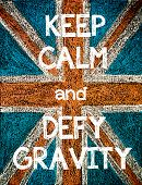 picture of gravity  - Keep Calm and Defy Gravity. United Kingdom (British Union jack) flag vintage hand drawing with chalk on blackboard humor concept image - JPG
