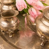 foto of pompous  - antik table set with pink tulips on a bronze ground - JPG