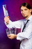 picture of bartender  - Young stylish man bartender with bottle alcohol pouring a drink - JPG
