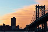 stock photo of brooklyn bridge  - Manhattan Bridge and skyline silhouette view from Brooklyn in New York City at sunset - JPG