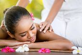 picture of spa massage  - Woman having Balinese massage in the spa salon - JPG