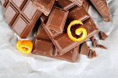 stock photo of orange peel  - Chocolate with orange peels on parchment - JPG