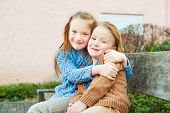 picture of brother sister  - Two cute kids sitting on a bench - JPG