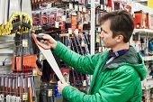 picture of hardware  - The Man Buying Handsaw In Hardware Store - JPG