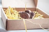 picture of edible  - Edible noname nobrand chocolate camera present for photographer  - JPG
