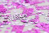 stock photo of sissi  - Pink happy birthday confetti pieces  - JPG