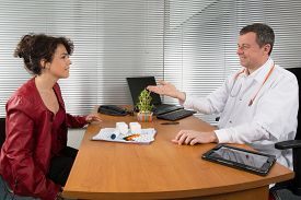 picture of prophylactic  - Businessman with Female Doctor at her office - JPG