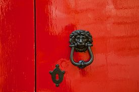 pic of lion  - Old red door with lion head metal knockers Mdina Malta - JPG