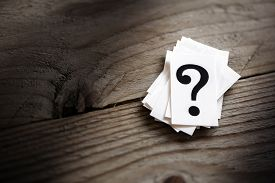 stock photo of confusing  - Question mark heap on table concept for confusion - JPG