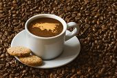 foto of continent  - Still life photography of hot coffee beverage with map of EurAsia continent - JPG