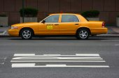 stock photo of side view  - Parked yellow taxi side view Manhattan New York - JPG