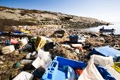 Garbage piled up on the coast of the ocean.