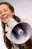 Beautiful young girl with megaphone over white