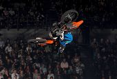 pic of moto-x  - A freestyle moto-x rider goes through a trick during an indoor competition.